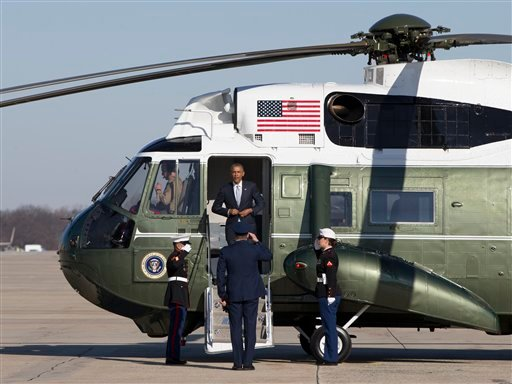 President Barack Obama steps from Marine One before boarding Air Force One, Friday, Jan. 9, 2015, at Andrews Air Force Base, Md., en route to Tennessee where he will discuss new initiatives to help more Americans go to college and get the skills they need