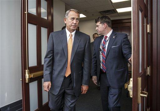 House Speaker John Boehner of Ohio, departs a closed-door meeting on Capitol Hill in Washington, Friday, Jan. 9, 2015. (AP)