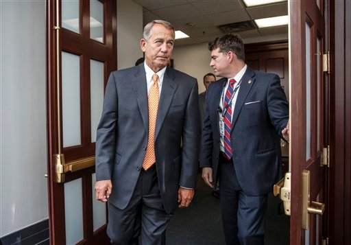 House Speaker John Boehner of Ohio, departs a closed-door meeting on Capitol Hill in Washington, Friday, Jan. 9, 2015. (AP)