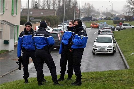 Police officers control the access to Dammartin-en-Goele, northeast of Paris, Friday Jan. 9, 2015. (AP)