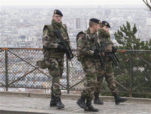 French soldiers patrol around the Sacre Coeur basilica at Montmartre district, in Paris, Monday, Jan. 12, 2015. (AP Photo/Jacques Brinon)