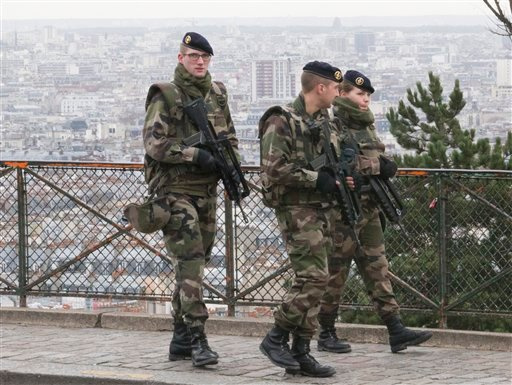 French soldiers patrol around the Sacre Coeur basilica at Montmartre district, in Paris, Monday, Jan. 12, 2015. (AP Photo/Jacques Brinon)