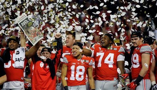 Ohio State players celebrate after the NCAA college football playoff championship game against Oregon Monday, Jan. 12, 2015, in Arlington, Texas. Ohio State won 42-20.