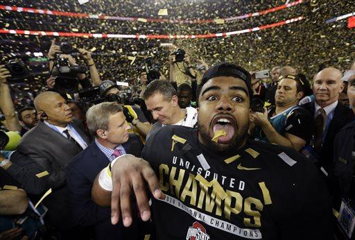 Ohio State's Ezekiel Elliott celebrates after the NCAA college football playoff championship game against Oregon Monday, Jan. 12, 2015, in Arlington, Texas. Ohio State won 42-20.