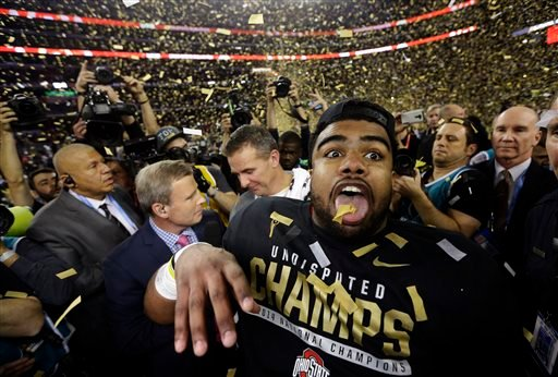 Ohio State's Ezekiel Elliott celebrates after the NCAA college football playoff championship game against Oregon Monday, Jan. 12, 2015, in Arlington, Texas. Ohio State won 42-20.