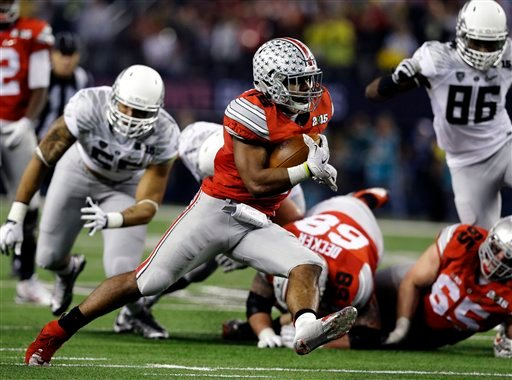 Ohio State's Ezekiel Elliott runs during the second half of the NCAA college football playoff championship game against Oregon Monday, Jan. 12, 2015, in Arlington, Texas.