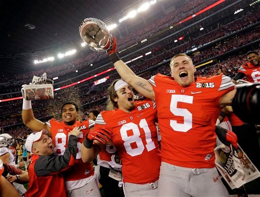 Ohio State's Braxton Miller (5) and Nick Vannett (81) celebrate after the NCAA college football playoff championship game against Oregon Monday, Jan. 12, 2015, in Arlington, Texas. Ohio State won 42-20.