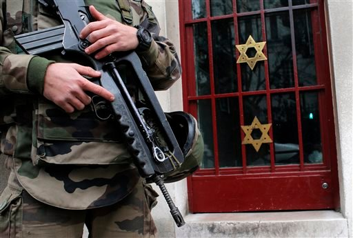 A soldier stands guard outside a synagogue in Neuilly sur Seine, outside, Paris, France, Tuesday, Jan. 13, 2015. (AP)