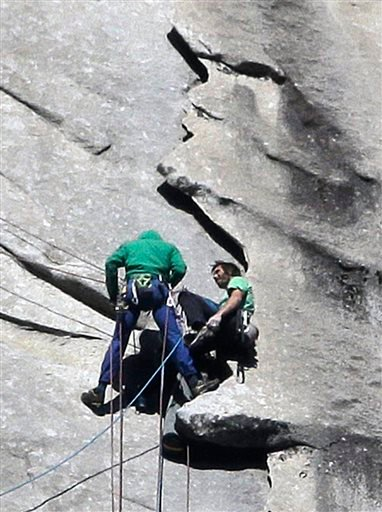 Tommy Caldwell, left, and Kevin Jorgeson near the summit of El Capitan Wednesday, Jan. 14, 2015, as seen from the valley floor in Yosemite National Park, Calif. (AP Photo/Ben Margot)
