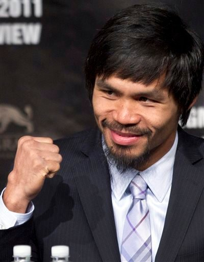 In this May 4, 2011, file photo, Manny Pacquiao pumps his fist during a news conference in Las Vegas.
