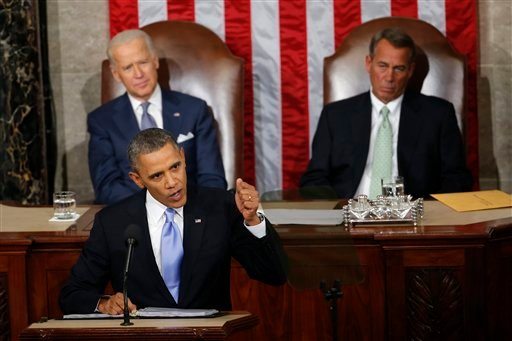 In this Jan. 28, 2014 file photo, Vice President Joe Biden and House Speaker John Boehner of Ohio listens as President Barack Obama gives his State of the Union address on Capitol Hill in Washington. For the first time in his presidency, Obama stands bef