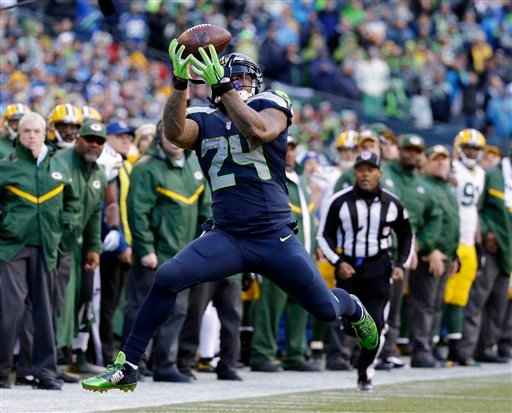 Seattle Seahawks' Marshawn Lynch catches a pass during the second half of the NFL football NFC Championship game against the Green Bay Packers Sunday, Jan. 18, 2015, in Seattle. (AP Photo/Elaine Thompson)