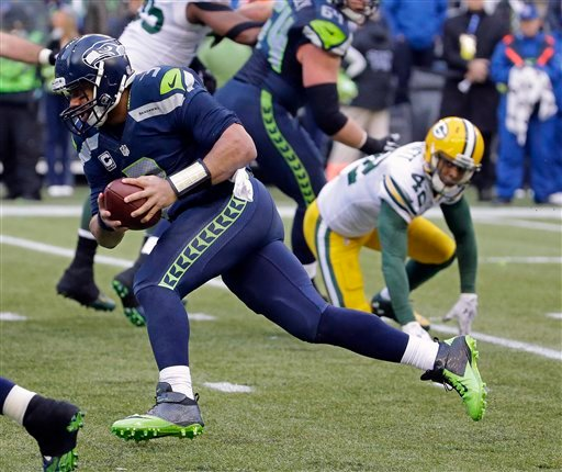 Seattle Seahawks' Russell Wilson runs for a touchdown during the second half of the NFL football NFC Championship game against the Green Bay Packers Sunday, Jan. 18, 2015, in Seattle.