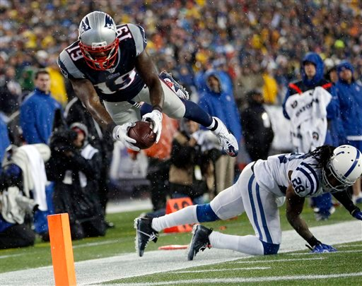 New England Patriots wide receiver Brandon LaFell (19) dives over Indianapolis Colts cornerback Greg Toler (28), but he had stepped out of bounds before reaching the end zone