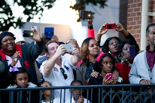 """Fans line up with their cellular phones to take photos of Oprah Winfrey before she marches to Edmund Pettus Bridge in honor of Martin Luther King Jr., Sunday, Jan. 18, 2015, in Selma, Ala. Winfrey joined some of the cast to promote the movie """"Selma,"""" alon"""