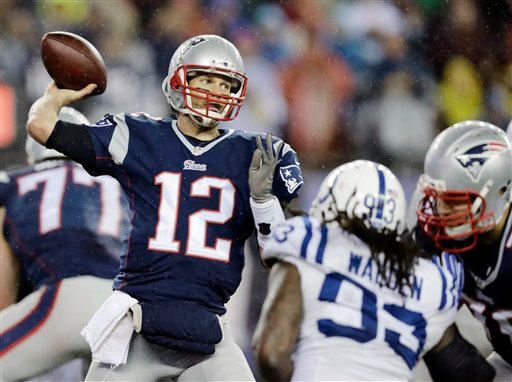 New England Patriots quarterback Tom Brady (12) passes against the Indianapolis Colts during the second half of the NFL football AFC Championship game Sunday, Jan. 18, 2015, in Foxborough, Mass. (AP Photo/Charles Krupa)