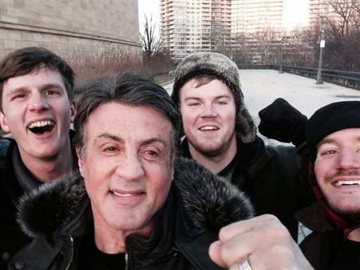In this Jan. 17, 2015, photo provided by Peter Rowe, Rowe, right, takes a selfie with friends Jacob Kerstan, left, Andrew Wright, third from left and actor Sylvester Stallone in Philadelphia. (AP)