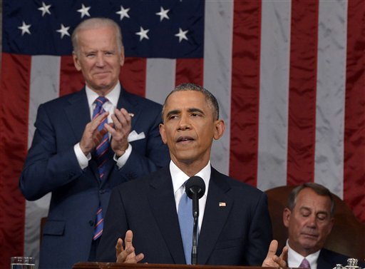 President Barack Obama delivers his State of the Union address to a joint session of Congress on Capitol Hill on Tuesday, Jan. 20, 2015, in Washington, as Vice President Joe Biden applauds and House Speaker John Boehner of Ohio, listens. (AP Photo)