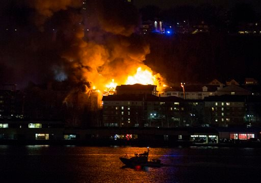 Smoke billows from a multi-alarm fire burning in Edgewater, N.J., as seen in New York from across the Hudson River, Wednesday, Jan. 21, 2015. (AP Photo/Craig Ruttle)