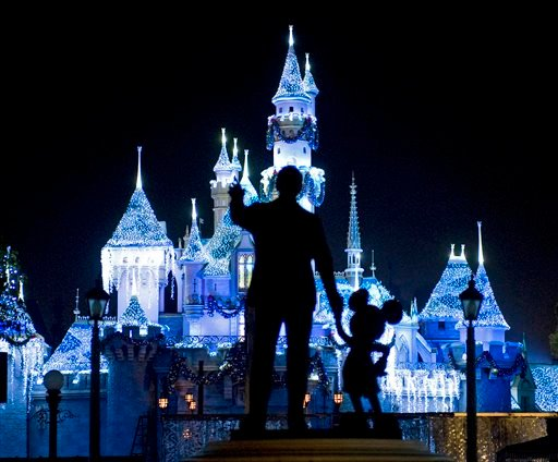 "This Nov. 20, 2009 photo shows Sleeping Beauty's Castle in winter dress with the iconic ""Partners"" statue featuring images of Walt Disney and Mickey Mouse in the foreground, at Disneyland in Anaheim, Calif."