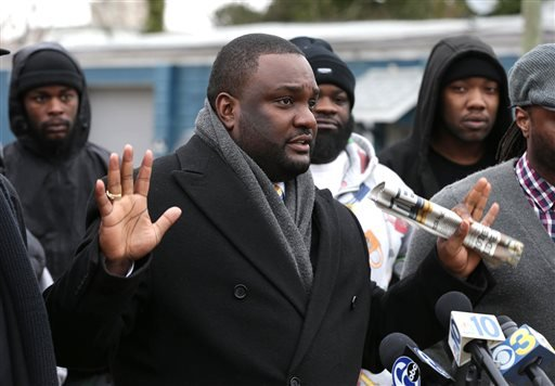 National Awareness Alliance spokesperson Walter Hudson, of Penns Grove, speaks to the media during a press conference in front of the Cumberland County Prosecutor's Office in Bridgeton, NJ Jan. 21, 2015. (AP Photo/The Press of Atlantic City, Michael Ein)