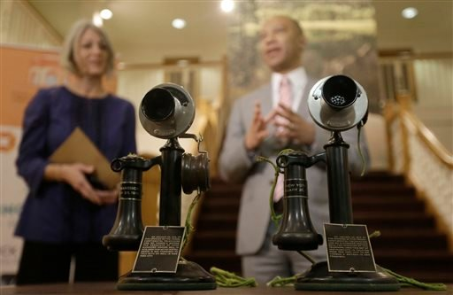 Dr. Anthea Hartig, executive director of the California Historical Society, left, and Ken McNeely, president of AT&T California, speak behind telephones used on the first transcontinental call, Jan. 22, 2015. (AP)