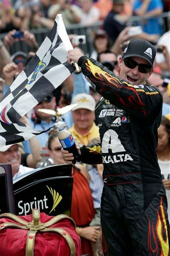 In this July 27, 2014, file photo, Jeff Gordon celebrates after winning the NASCAR Brickyard 400 auto race at Indianapolis Motor Speedway in Indianapolis.