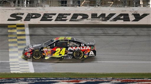 In this May 10, 2014, file photo, NASCAR driver Jeff Gordon (24) crosses the finish line to win the Sprint Cup Series auto race at Kansas Speedway in Kansas City, Kan.