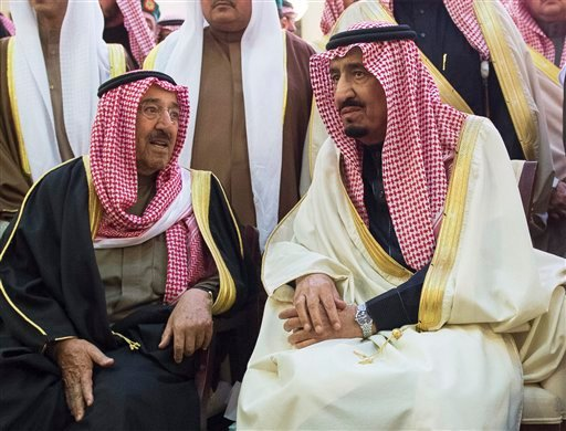 In this photo provided by the Saudi Press Agency, Saudi Arabia's newly enthroned King Salman, right, talks with Kuwait's Emir Sheikh Sabah Al-Ahmad Al-Jaber Al-Sabah during the funeral of Salman's half brother King Abdullah at the Imam Turki bin Abdullah