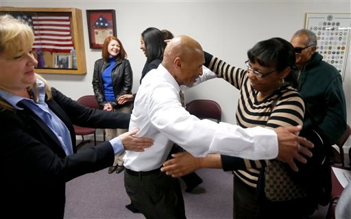 Joseph Sledge hugs his sister Barbara Kinlaw after a special session of superior court in Whiteville, N.C. on Friday, Jan. 23, 2015. (AP)