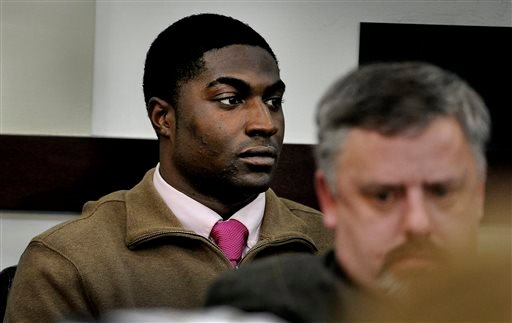 "Defendant Cory Batey listens to the testimony of Jaborian ""Tip"" McKenzie during the rape trial of Batey, McKenzie, Brandon Vandenburg and Brandon Banks on Tuesday, Jan. 20, 2015, in Nashville in Tenn. (AP Photo/The Tennessean, John Partipilo)"