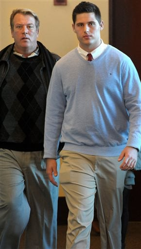 Brandon Vandenburg leave the court for the day with his father Rob Vandenburg after the 8th day of the Vanderbilt rape trial on Wednesday Jan. 21, 2015, in Nashville. (AP Photo/The Tennessean, John Partipilo)