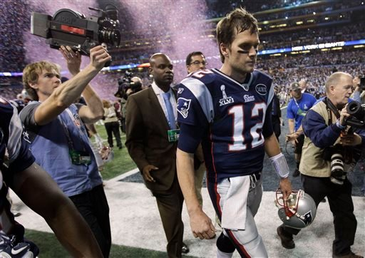 FILE - In this Feb. 5, 2012, file photo, New England Patriots quarterback Tom Brady walks off the field after the Patriots' 21-17 loss to the New York Giants in NFL football's Super Bowl XLVI in Indianapolis. (AP)