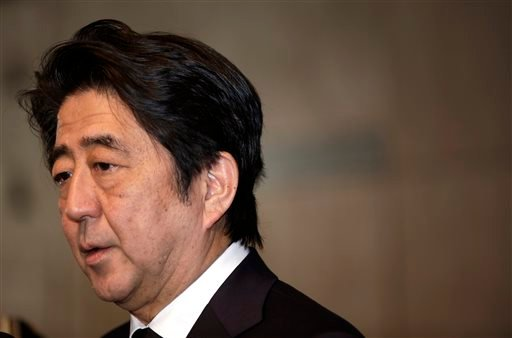 "Japanese Prime Minister Shinzo Abe speaks to the media after he signed a book of condolence for the late King Abdullah of Saudi Arabia at Saudi Arabian Embassy in Tokyo Sunday, Jan. 25, 2015. Abe said earlier in the day he was ""speechless"" after an online"