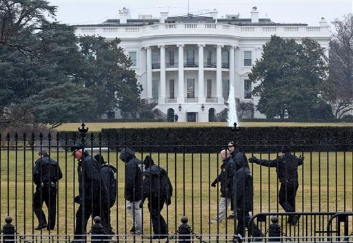 Secret Service officers search the south grounds of the White House in Washington, Monday, Jan. 26, 2015. A device, possibly an unmanned aerial drone, was found on the White House grounds during the middle of the night while President Barack Obama and the