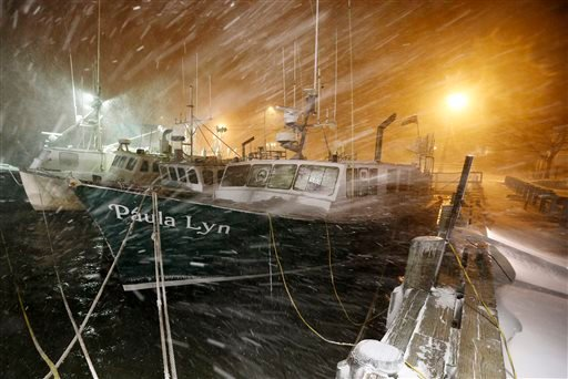 Fishing boats ride out the storm at dock in Scituate, Mass., Tuesday, Jan. 27, 2015. The winter storm packing blizzard conditions spun up the East Coast early Tuesday, pounding parts of coastal New Jersey northward through Maine with high winds and heavy