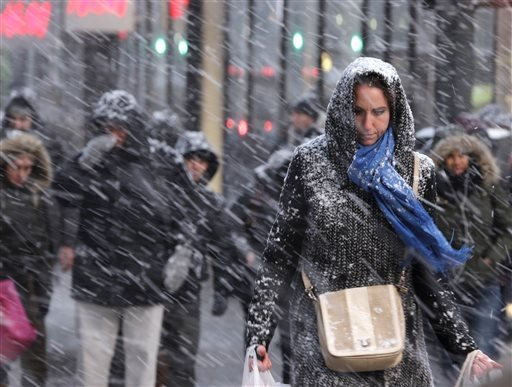Pedestrians make their way through snow in New York, Monday, Jan. 26, 2015. More than 35 million people along the Philadelphia-to-Boston corridor rushed to get home and settle in Monday as a fearsome storm swirled in with the potential of 1 to 3 feet of s