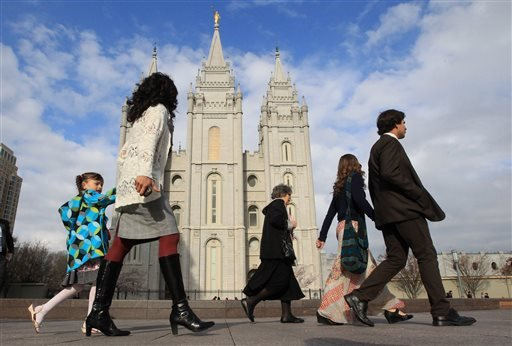 """In this April 5, 2014 file photo, people walk past the Salt Lake Temple in Salt Lake City. On Tuesday, Jan. 27, 2015, Mormon leaders made a national appeal for what they called a """"balanced approach"""" in the clash between gay rights and religious freedom, p"""