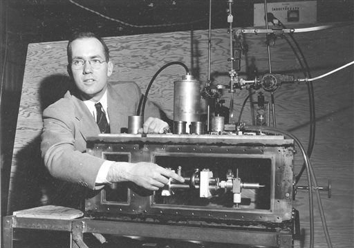 File - In this Jan. 25, 1955, file photo, Charles Hard Townes, Columbia University professor and Nobel laureate, explains his invention the maser during a news conference in New York City. (AP)
