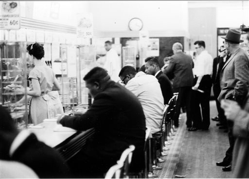 """FILE - In this February 1960 file photo, people take part in a civil rights """"sit-in"""" protest at the lunch counter in McCrory's in Rock Hill, S.C. (AP)"""