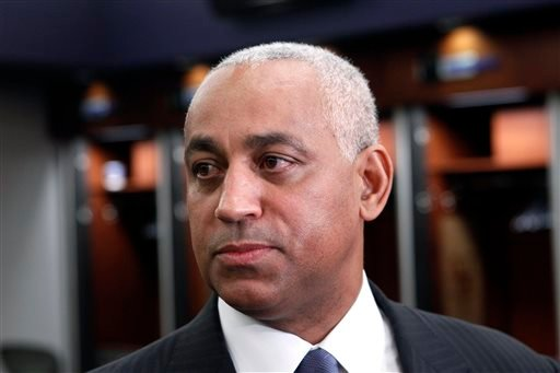 In this Oct. 4, 2010, file photo, Omar Minaya speaks to the media in the New York Mets clubhouse at Citi Field in New York.