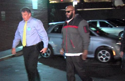"""This image from video shows Death Row Records founder Marion """"Suge"""" Knight, right, walking into the Los Angeles County Sheriffs department early Friday morning Jan. 30, 2015 in connection with a hit-and-run incident that left one man dead and another inju"""