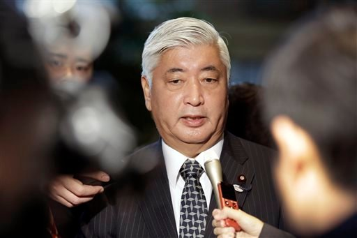 Japan's Defense Minister Gen Nakatani answers reporters' questions at the prime minister's official residence in Tokyo, Friday, Jan. 30, 2015. (AP Photo/Eugene Hoshiko)