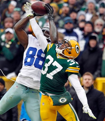In this Jan. 11, 2015, file photo, Dallas Cowboys wide receiver Dez Bryant (88) catches a pass against Green Bay Packers cornerback Sam Shields (37) during the second half of an NFL divisional playoff football game in Green Bay, Wis. The play was reversed