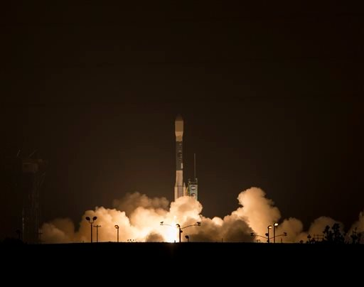 This photo provided by NASA, A Delta 2 rocket carrying the Soil Moisture Active Passive, SMAP ,satellite launches early Saturday, Jan. 31, 2015 from Vandenberg Air Force Base, Calif. The launch is a three-year mission to track the amount of water locked i
