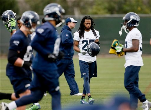 Seattle Seahawks' Richard Sherman puts his helmet on during a team practice for NFL Super Bowl XLIX football game, Thursday, Jan. 29, 2015, in Tempe, Ariz. The Seahawks play the New England Patriots in Super Bowl XLIX on Sunday, Feb. 1, 2015. (AP Photo/Ma