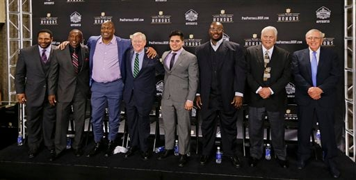 Members of the NFL Pro Football Hall of Fame class of 2015 are introduced Saturday, Jan. 31, 2015, in Tempe, Ariz. From left are running back Jerome Bettis; wide receiver Tim Brown; defensive end and linebacker Charles Haley; Bill Polian; Tyler Seau, son