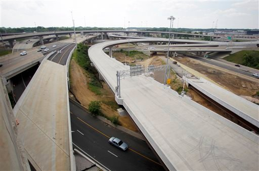In this Wednesday, May 16, 2012 file photo, newly constructed roadways are being built in Fairfax County, Va. President Barack Obama's budget will propose an ambitious six-year, $478 billion public works program of highway, bridge and transit upgrades, h
