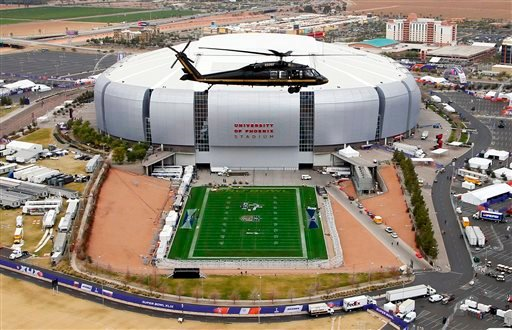 In this Monday, Jan. 26, 2015, file photo, with the grass field tray outside, a U.S. Customs and Border Protection Black Hawk helicopter circles above University of Phoenix Stadium, site of the NFL Super Bowl XLIX football game, during a security demonstr