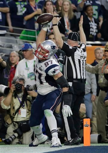 New England Patriots tight end Rob Gronkowski (87) spikes the ball as he celebrates a touchdown during the first half of NFL Super Bowl XLIX football game against the Seattle Seahawks Sunday, Feb. 1, 2015, in Glendale, Ariz. (AP Photo/Matt Slocum)